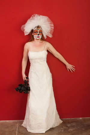 pranks: Lady in a Bridal Wear leans agains the wall for All Souls Day