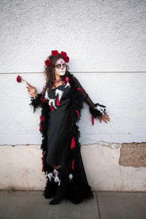 Middle aged woman with roses in her hair for All Souls Day photo