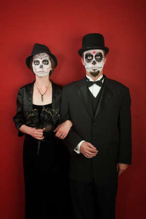 freaky: A classy couple with freaky make up for Halloween or All Souls Day