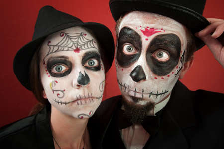 all souls day: A Classy Couple wearing skull make-up for All Souls Day Stock Photo
