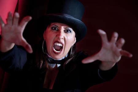 ringmaster: Woman dressed like a circus ringmaster
