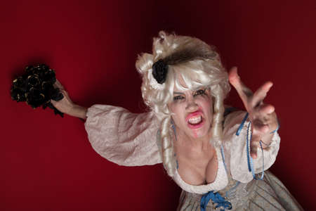 Woman wearing a Marie Antoinette costume appealing for her life photo