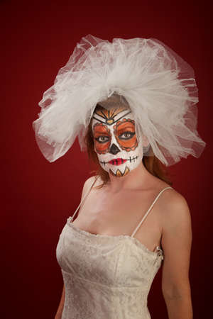 A pretty woman with bridal wear and Day of the Dead make-up photo