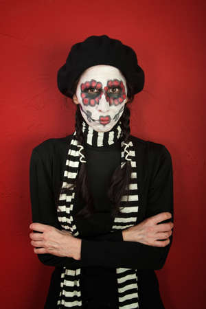 skinny woman: A skinny woman with All Souls Day makeup in folding her arms