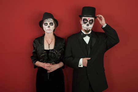 A classy couple with skeleton make up for Halloween or All Souls Day