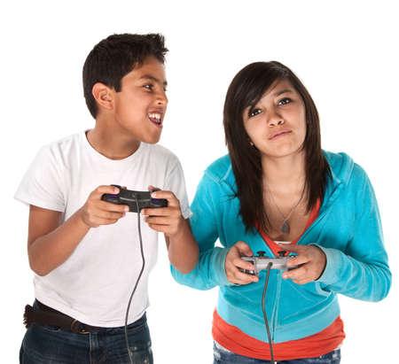 Two young cute Hispanic kids playing video games Stock Photo