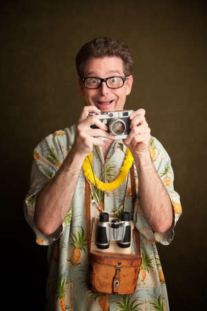 hairy arms: Nerdy pacific island tourist with a silly grin, camera and binoculars Stock Photo