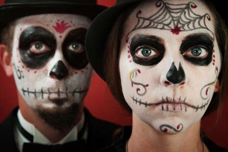 all souls' day: Classy middle-aged couple pose in All Souls Day Makeup