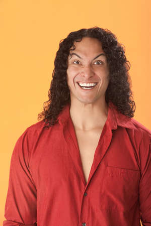 daft: Native American with a Crazed Grin and Red Shirt on Orange Background