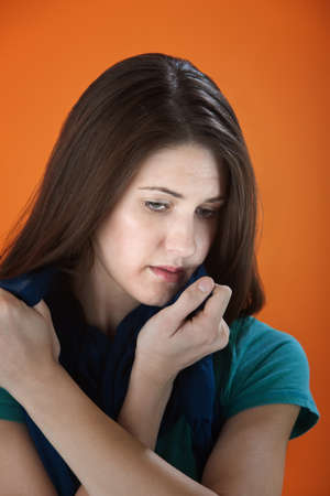 Sad young woman holds a scarf tightly near her face Stock Photo - 8575351