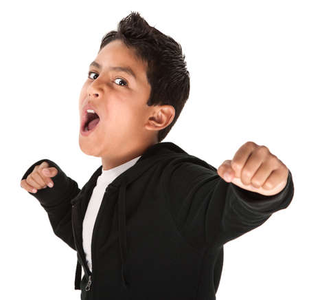 mean: Young Hispanic kid showing fist and ready to fight on white background Stock Photo