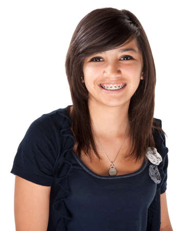 Cute Hispanic teenage girl with braces and a big smile photo