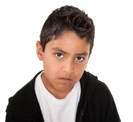 mean: Young hispanic boy with a serious attitude on a white background
