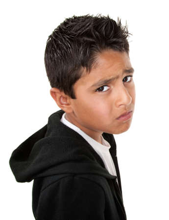 Whiny or sad Hispanic male on white background Banque d'images
