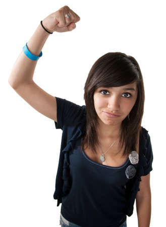 Cute young latino girl on white background making a fist