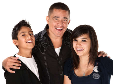 Smiling Hispanic father with happy children on white background Stock Photo