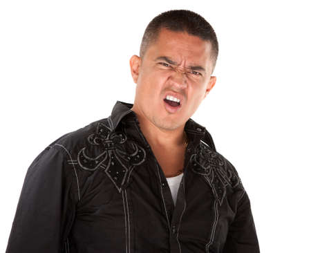 Annoyed middle-aged Hispanic man on white background photo