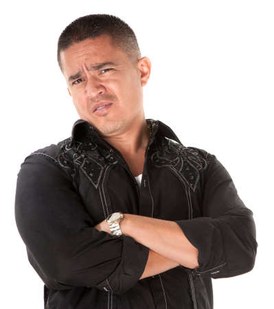 Unimpressed or offended Native American with folded arms on white background Stock Photo - 8924332
