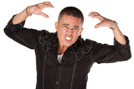 Enraged middle-aged Hispanic man with raised hands on white background Stock Photo - 8924336
