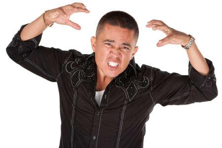 Enraged middle-aged Hispanic man with raised hands on white background Stock Photo - 8924336
