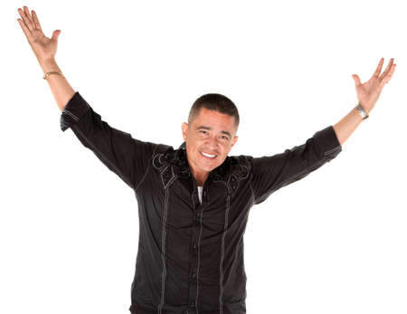 big shirt: Latino man smiling with raised arms on white background
