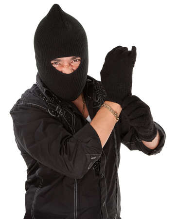 troublemaker: Angry burglar wearing a black woollen mask Stock Photo