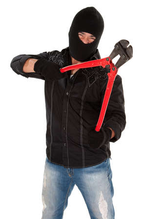 wire cutters: Masked robber holding huge red and black wire cutters Stock Photo