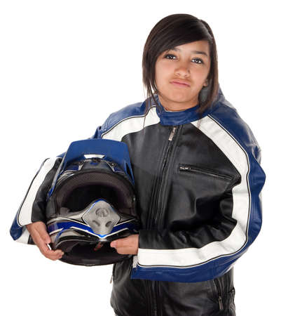 single track: Mexican teenaged racer girl with motorcycling suit and helmet in hand