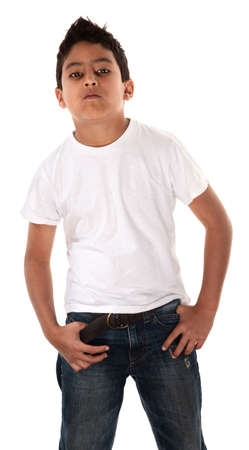 defiant: Young Hispanic child in t-shirt and hands pockets with an attitude