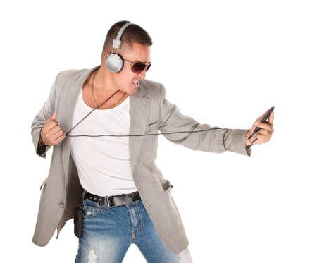 Middle aged Hispanic man dances while listening to music photo