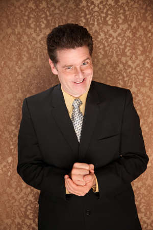 Young Caucasian businessman wearing a sly smile