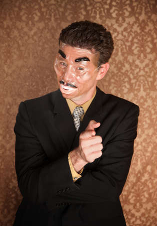 Masked businessman on damask background pointing straight ahead photo