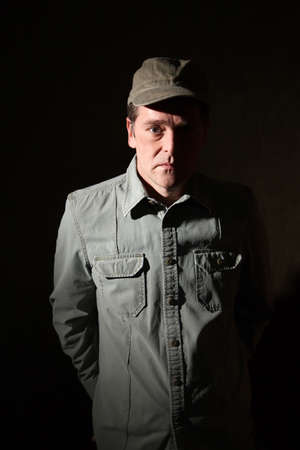 Serious military man isolated on a dark background photo