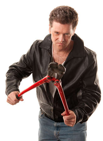 law breaking: Tough criminal in leather jacket with heavy-duty cutters