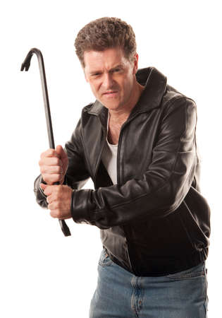 Angry man in leather jacket ready to strike with a crowbar photo