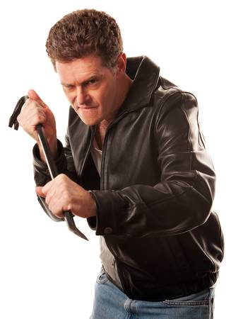 Man ready to force apart something using a crowbar photo