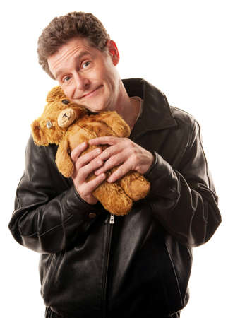 Man in leather jacket clasps teddy bear photo