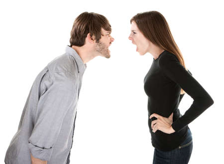 couple arguing: Young Caucasian couple arguing on white background