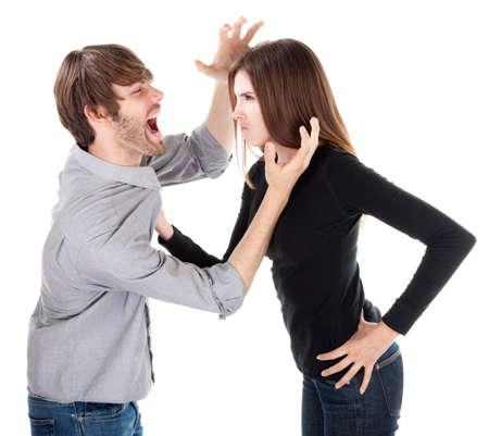 Ehefrauen: Young Caucasian Woman holding ihr Freund oder Ehemann von seiner Kragen Lizenzfreie Bilder