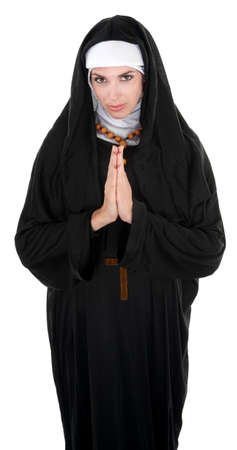 religious clothing: Nun praying for the well-being of all  Stock Photo