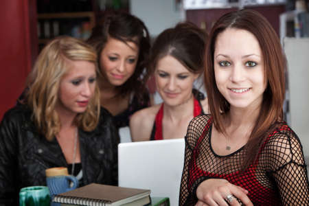 Young woman with three friends take a break from studying photo