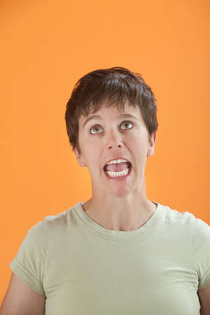 obnoxious: Frustrated young lady screaming on top of her voice