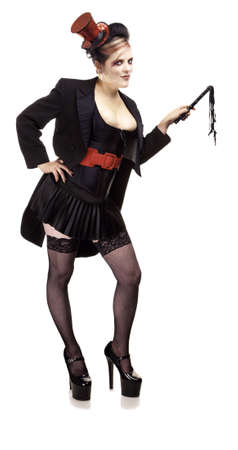 Sexy female ringmaster or lion tamer with small whip