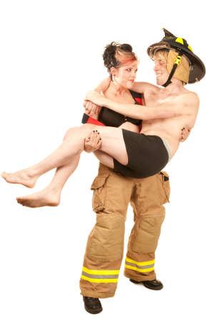 Sexy female firefighter rescuing a grateful handsome man photo