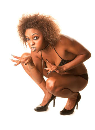 Beautiful African-American Cat Woman Crouching in Bikini and High Heels photo