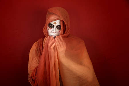 Woman with makeup for Day of the Dead covered with a scarf photo