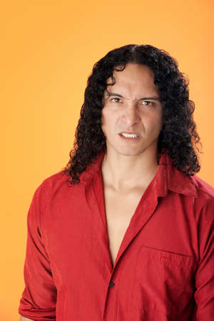 disgusted: Disgusted muscular Native American man on orange background