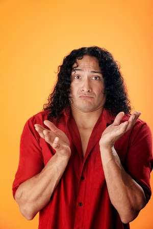contradict: Native American man with open hands of innocence on orange background