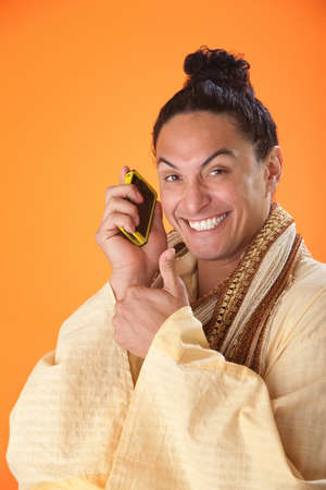 raised eyebrow: Japanese Samurai man smiling with big grin showing thumbs up while talking on a mobile phone