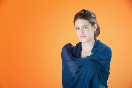 Attractive young woman with a blue scarf covering her shoulders photo